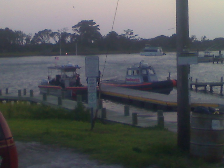 Coast Guard bringing in patient by boat